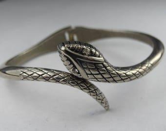 Gorgeous chrome 1980s snake bangle with crystal eyes