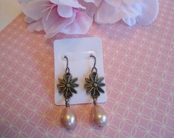 Pink daisy earrings:  Antique brass salmon pink daisy flower earrings with Vintaj brand earring hooks and head pins