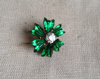 "Green ""flower"" brooch."