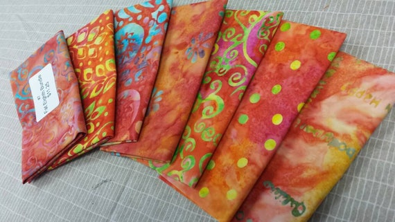BatikTextiles Fabric Bundle of 7 Fat Eighths For Quilting Those Spring Projects. Features Orange, Pink, Yellow, Blue and White Swirls