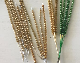 Collection of vintage Mercury glass bead picks in gold and green