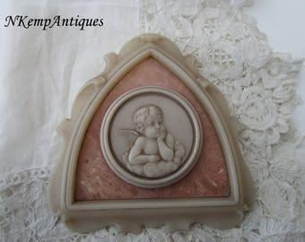Old cherub plaque