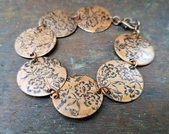Handmade salvaged copper round bracelet with vintage style floral flower bouquet design