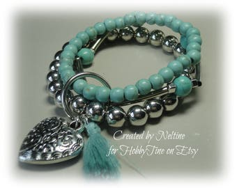Ladies 3 in one bracelet with heart charm and feather in aqua blue green and silver