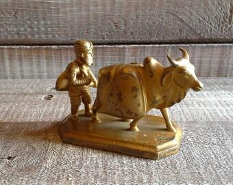 Vintage Metal Man and Bull Figurine