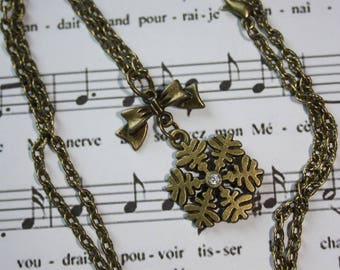 Bronze necklace and snowflake charm