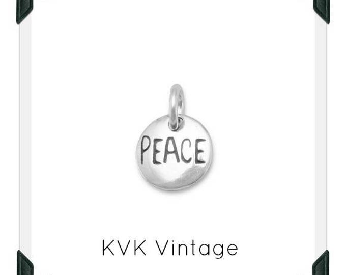 "Oxidized ""Peace"" Hand-Stamped Sterling Silver Charm"