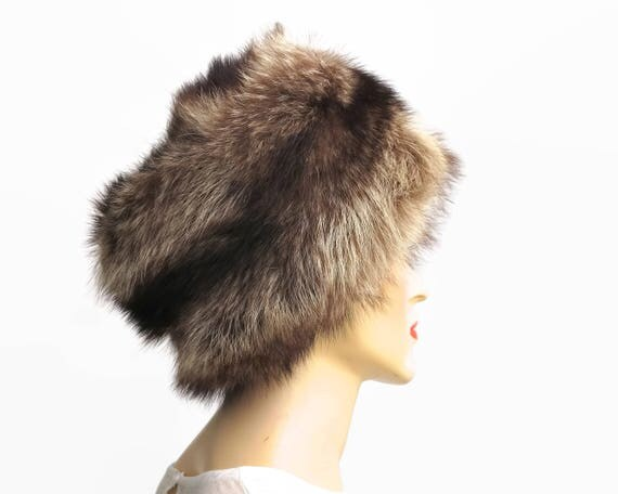 Mid 20th century genuine racoon fur hat with stripes in shades of brown, long fur, fully lined, average size, winter accessory, circa 1960s