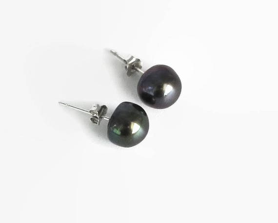 Black freshwater pearl stud earrings on sterling silver posts, single pearls that have undertones of purple and green
