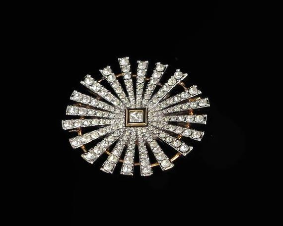 Large Swarovski brooch in gold tone metal, star burst pattern with radiating arms of crystals, Swarovski swan logo, original box, vintage