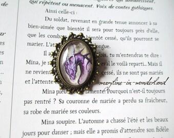 Oval bronze dragon brooch purple