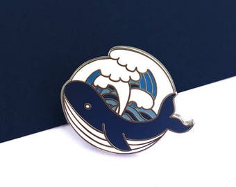 Pins whale and waves