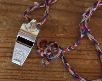 The Acme Thunderer Made In England Silver Whistle and braided Cord