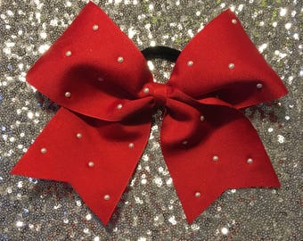 Red grosgrain cheer bow with pearls.