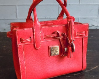 Vintage Dooney and Burke / Smaller Bag in Red / Textured Leather / French Paper Fabric Interior...not from an outlet