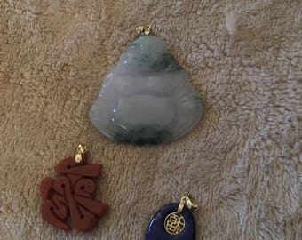 Choice of three Chinese hardstone pendants with 14k gold settings