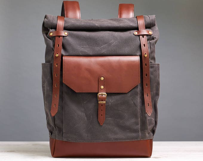 Waxed canvas backpack. Roll-top canvas bag.