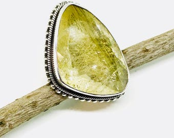 Rutilated Quartz Ring set in Sterling silver 925. Size -8. Natural authentic stone. Freeform shape.