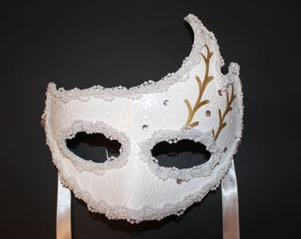White mask with gold design and diamonds