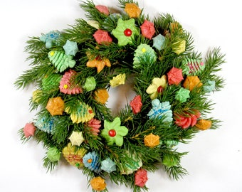 Wreath / Centerpiece, 10 inch, multicolor.  Artificial wreath with handmade, durable, salt-dough versions of holiday spritz cookies.