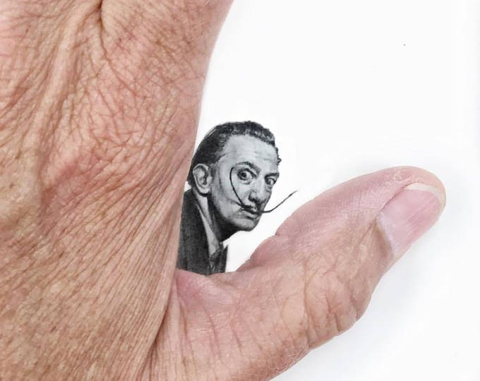 "Print of miniature painting of Salvador Dali .  1 1/4"" x 1 1/4"" print of tiny pencil sketch of salvidore Dali"