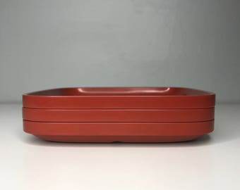 set of three 6-inch stackable retro Rosti Denmark Falle Uldall melamine plates in rust red