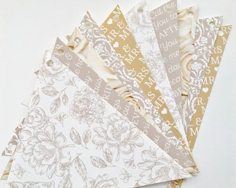 beige and white flowers wedding paper Garland and writings