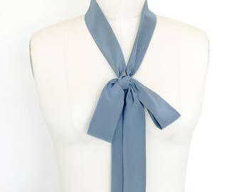 "Silk choker scarf is 63"" x 1.5"" in blue stone. Tie it as a headscarf, choker scarf, sash or in a classic bow. Skinny tie. Bow neck tie."