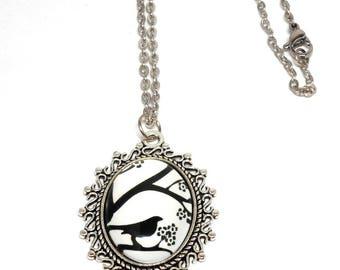 Black Bird on branch pendant necklace