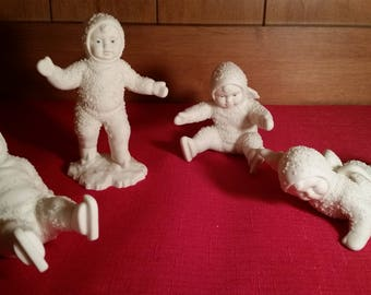 """Snowbabies by Department 56 """"Ice Skating All Fall Down"""" Porcelain Bisque Snow Baby Figurines - Set of Four (4)"""