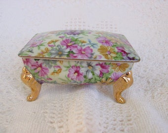 Small Vintage Porcelain 4 Footed Covered Trinket Jewelry Box in Chintz Floral Pattern w Gold Feet