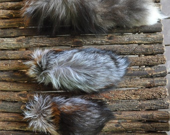 humanely Ranched Real fox tail keychains .