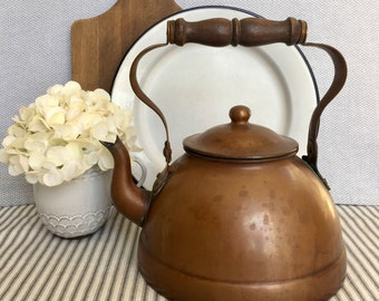 Beautifully Patinaed Copper Tea Kettle with Carved Wood Handle and Knob Item No. 1850