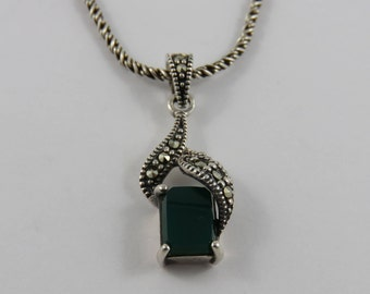 Sterling Silver Green Stone and Marcasite Pendant With A 16 Inch Light Twisted Rope Chain.