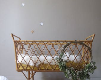 vintage rattan wicker rolling cradle crib design from the 60s