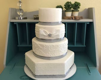 Faux wedding cake with bling and bow