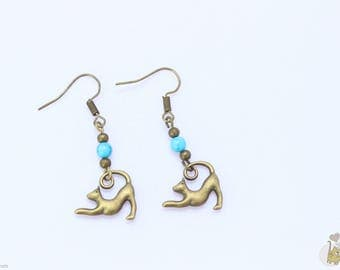Bronze dangle earrings adorned with turquoise beads and a cat charm