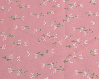 White Flowers on Pink Sheer Polyester Fabric