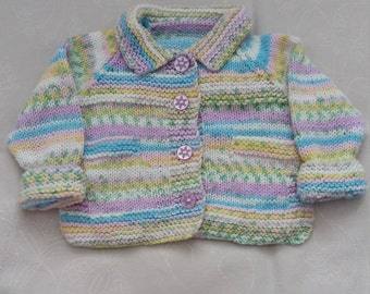 Hand knitted baby girls coat