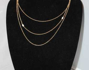 Vintage Avon 3 Strand Gold Tone Necklace With White Bead Accents
