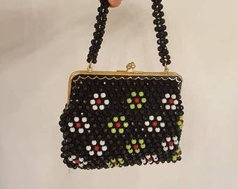 Bag Black beads with 60 years ' 50 or ' colored flowers