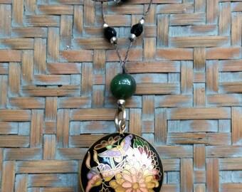 Oriental motif floral pendant necklace .