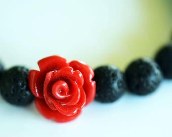 Lava bracelet with coral flower detail and coral stones