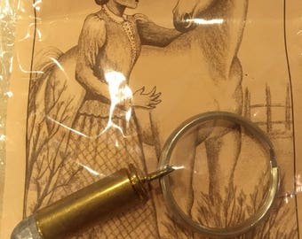 "Deactivated Bullet Keychain - Bullets that Tamed the Wild - 1800's Old West Bullet with Postcard about Belle Star, ""The Bandit Queen"""