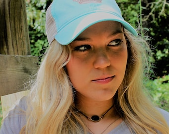 ROYALTY snap-back vintage-style trucker hat in aqua with cream and taupe crown graphic