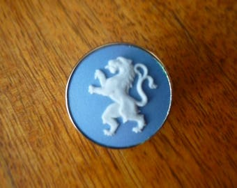 Wedgwood button of lion with gold edge and back.