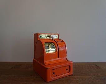 Vintage Orange Metal Bank Uncle Sam's 3 Coin Bank