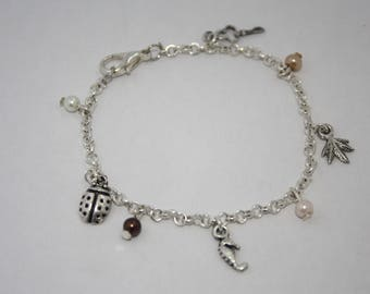 Bracelet chain with various charms and pearls