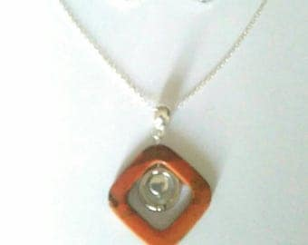 Orange set. Pendant/necklace and earrings.