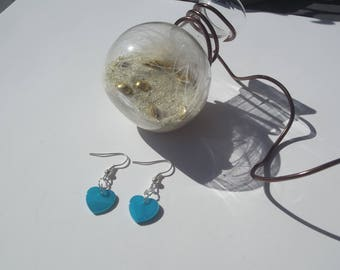 Dangling earrings in silver and blue heart sequin shell